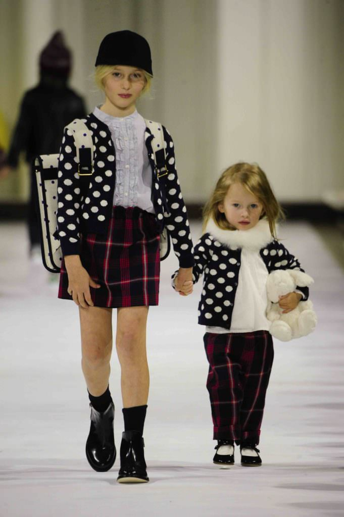 Plaids are all over the kids fashion collections for next winter and here Bonpoint mix them up with monochromatic spots