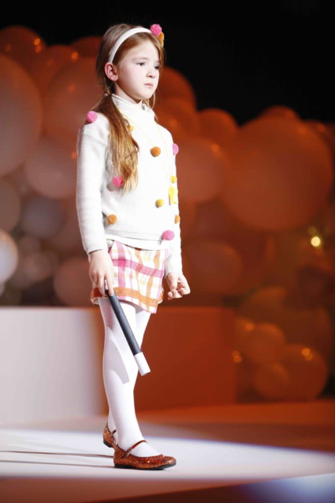 Pom poms and plaids with a magic stick kids fashion in Italy by Il Gufo fall 2017