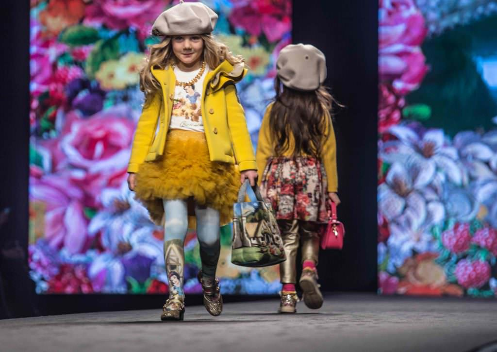 Toddlers with Snow White and the Seven Dwarves prints at the Monnalisa kids catwalk show in Florence at Pitti Bimbo 84