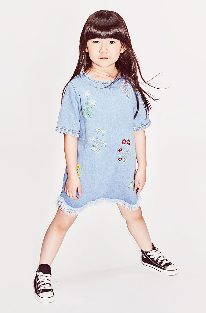 Simple flower embroidery and big fringed hems for denim by Stella McCartney at Childrensalon.com