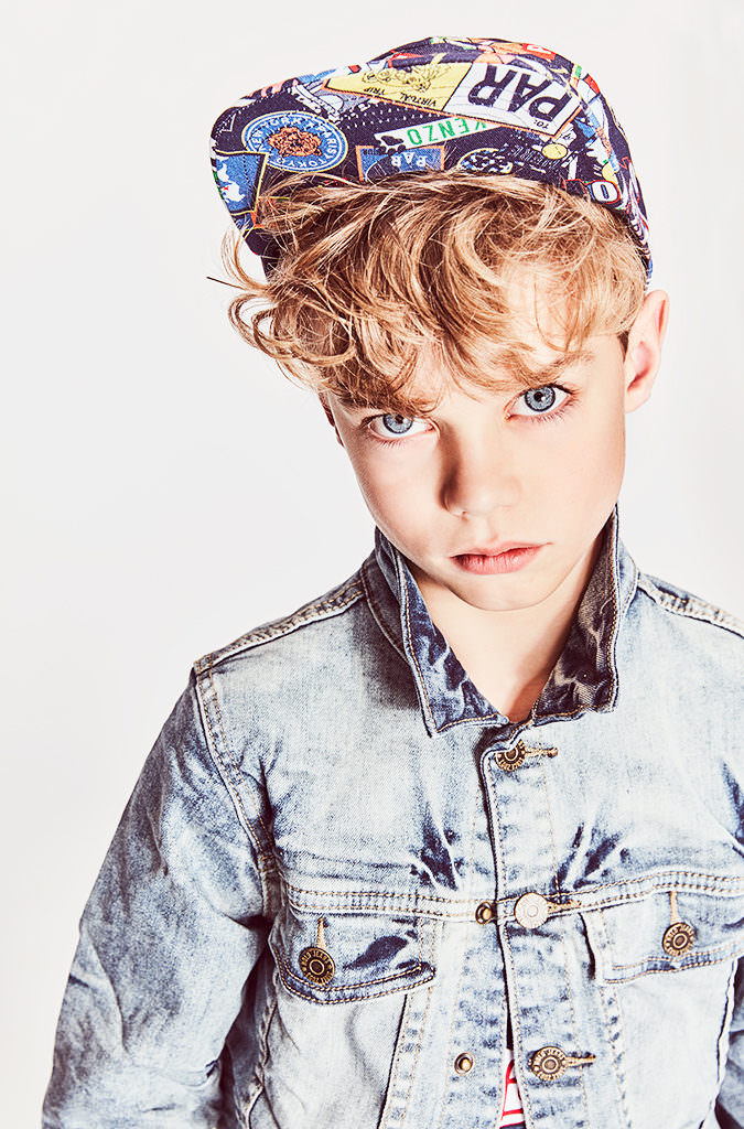 Molo bleached jacket, Kenzo hat for boyswear cool denim looks at Childrensalon photographed by Emma Tunbridge