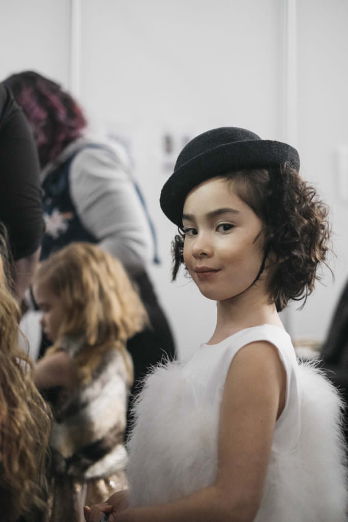 Sweet backstage shot at Petite Parade of Charabia kids fashion fall 2017 photo by Laura Fontaine