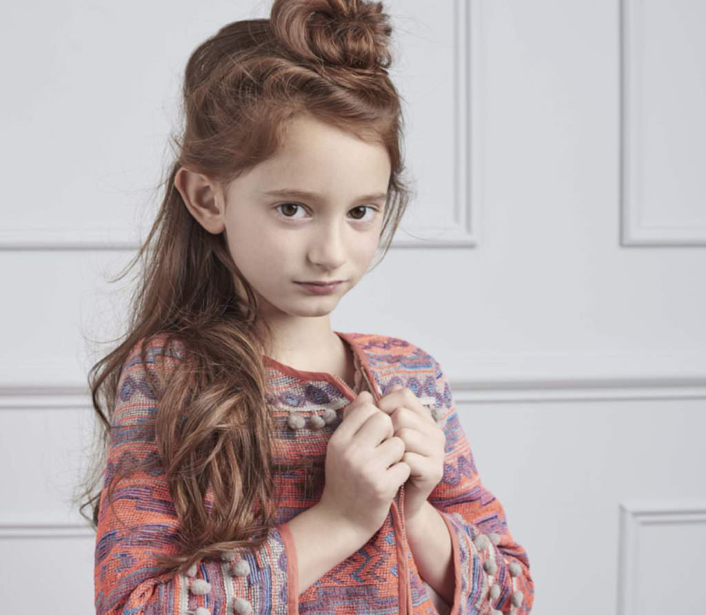 Embellished kids fashion at Outside the Lines with a pom pom decorated jacket for girls SS17