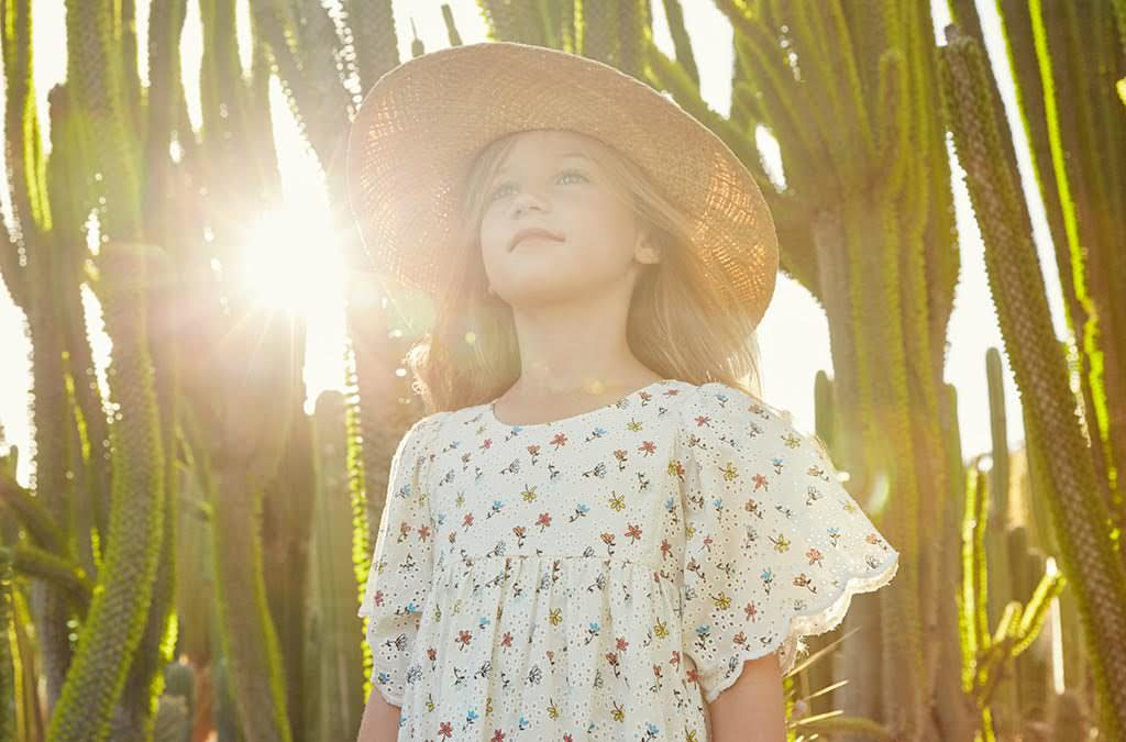 Ivory Broderie Anglaise print dress and sunhat by Chloe at Childrensalon
