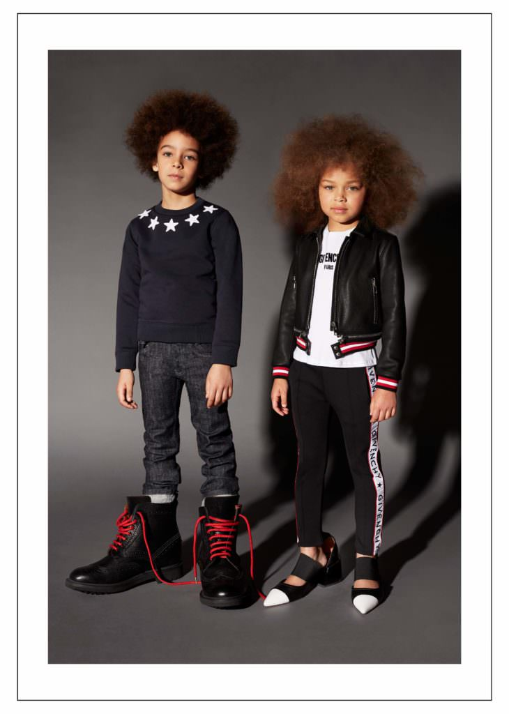 Givenchy Kids showing the star pattern signature and the logo strip track pants for fall 2017