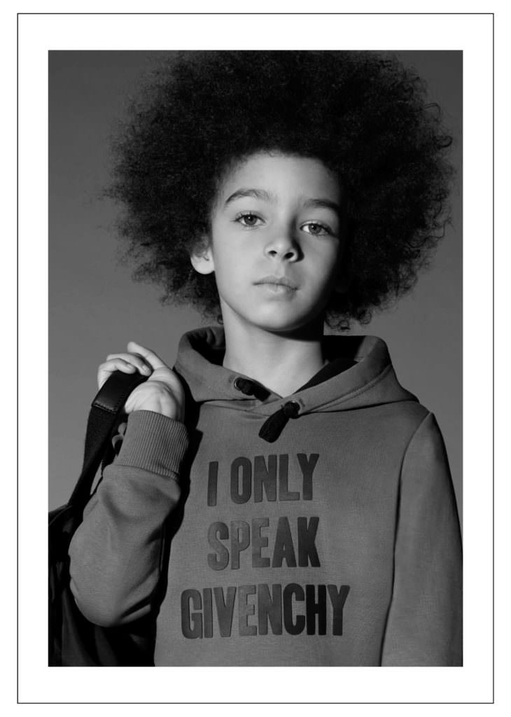 Graphic T-shirts with bold messages for boys at Givenchy Kids fall/winter 2017 collection