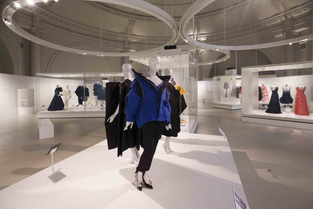 The upstairs gallery with the modern inspirations derived from Balenciaga's philosophy, in front the controversial off shoulder padded coat by Demna Gvasalia 2015