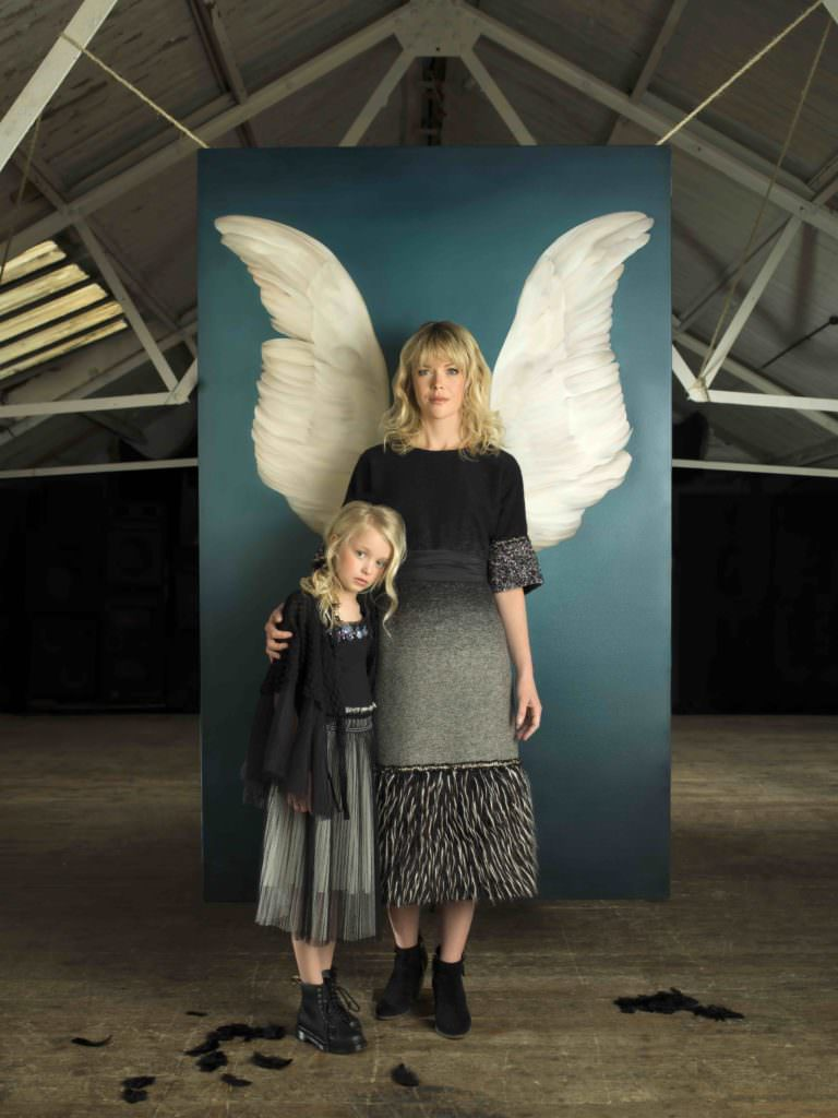 Family style portrait by Julia Boggio; Kirsty-Lee wears Rocky Star. Layla wears Noe and Zoe cape, Tutu Du Monde shirt, DKNY skirt and Dr Martens shoes.