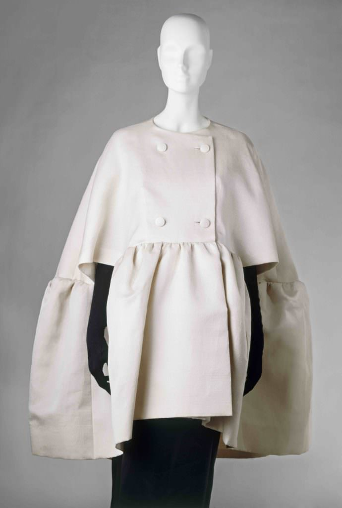 Woman`s double breasted evening cape; white gazar; front view; designed by Cristabel Balenciaga (1895 - 1972) February 1963.