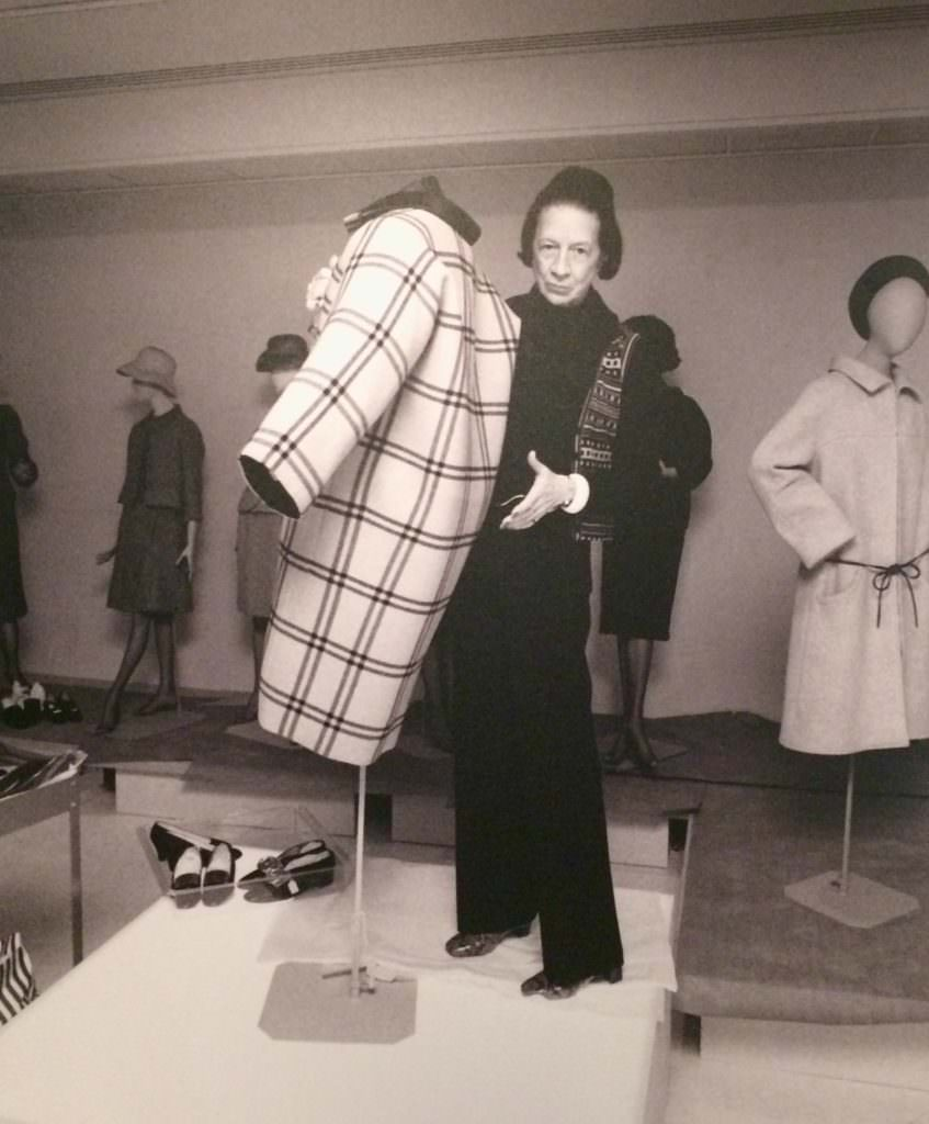 Diana Vreeland shows off the one seam Balenciaga coat for which you can take a simple paper sheet with the pattern and instructions on at the V&A exhibition