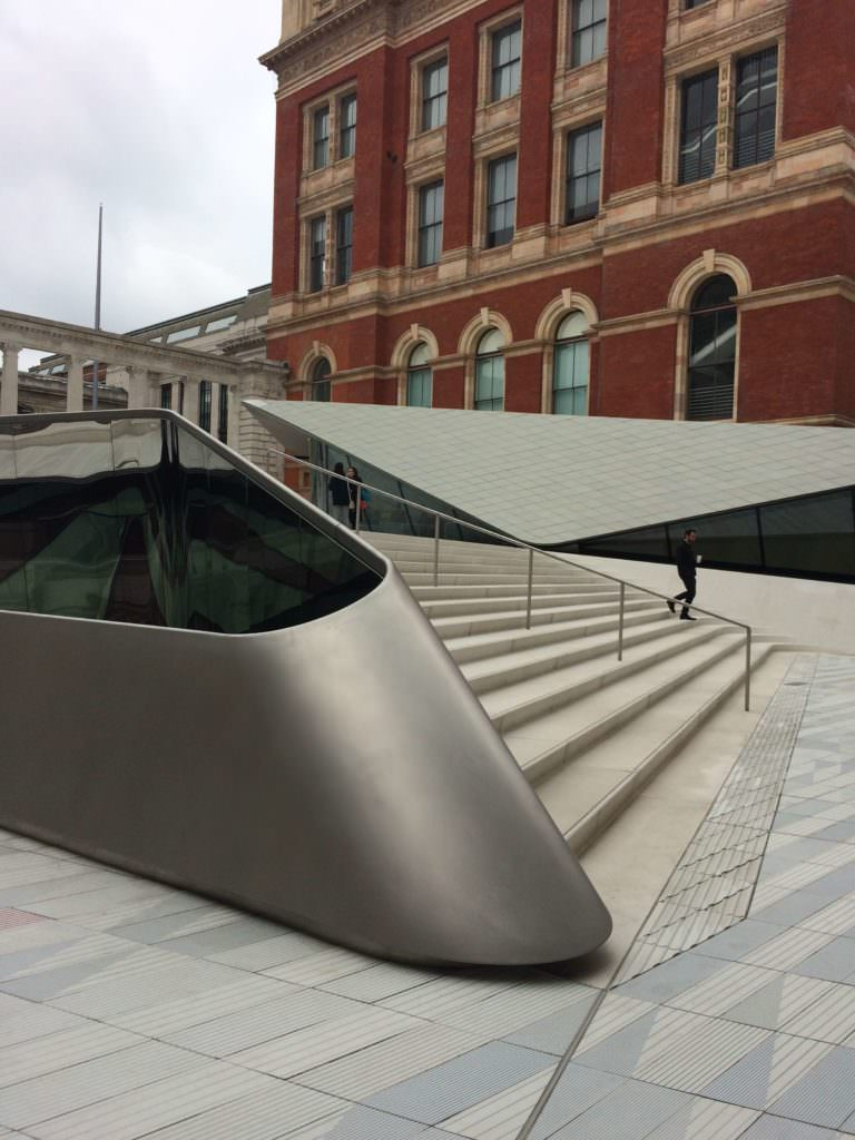 The new Exhibition Road Quarter entrance of the V&A Museum with the light well and in background cafe and shop