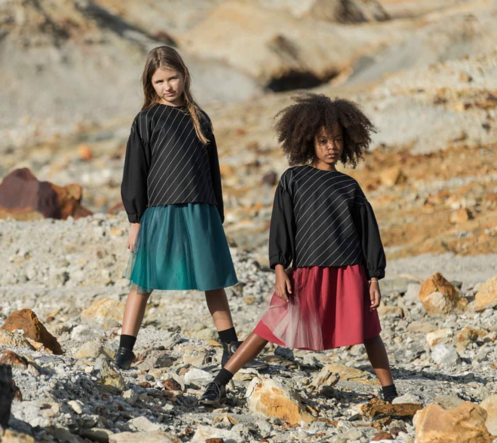 Black and grey tones are supplemented by maroon and teal highlights for Motoreta kidswear fall 2017