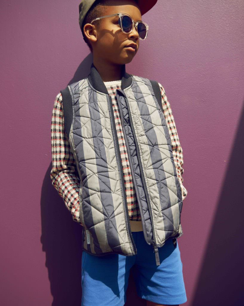 Anton in a quilt vest from MarMar, knit from FUB and shorts from Gro Company all for SS18 boys fashion from the catwalk at CIFF Kids