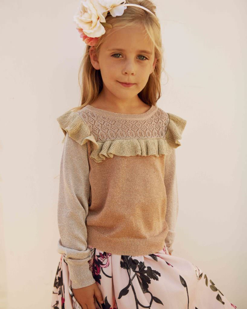 Sofia wears a top from MarMar, skirt from Kids Up and hair band by Creamie at CIFF Kids for SS18