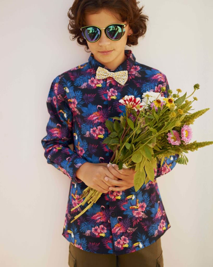 Flower boy Julius in a shirt by DWG, bow tie by Milledeux and shorts by Soft Gallery for CIFF Kids summer 2018