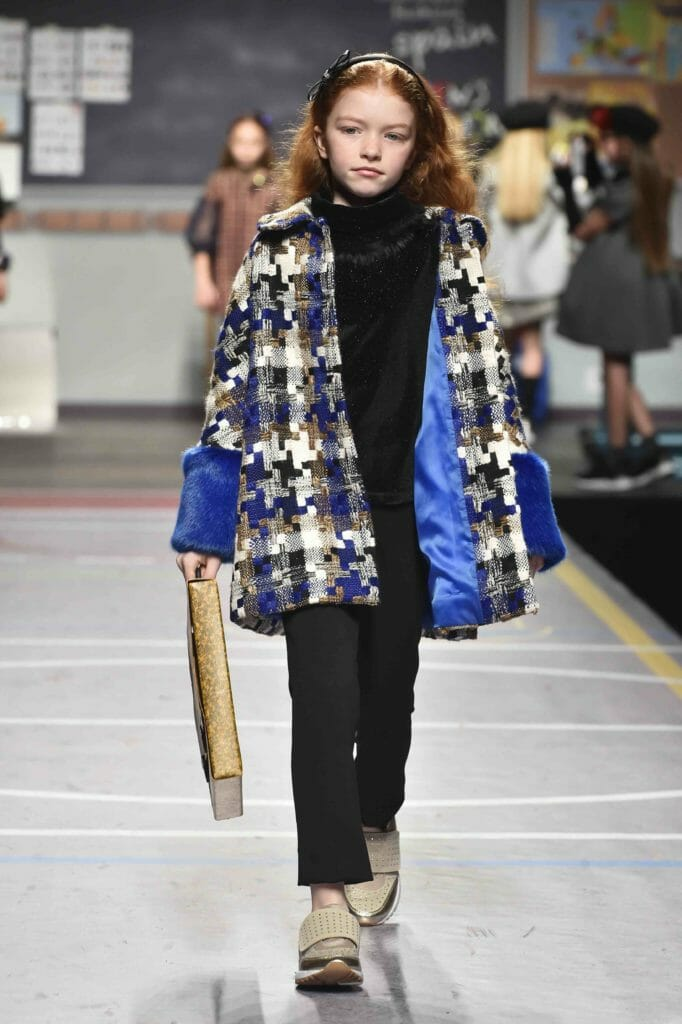 Barcarola from Spain combine bold faux fur and giant tweed checks at Pitti Bimbo for kidswear winter 2018