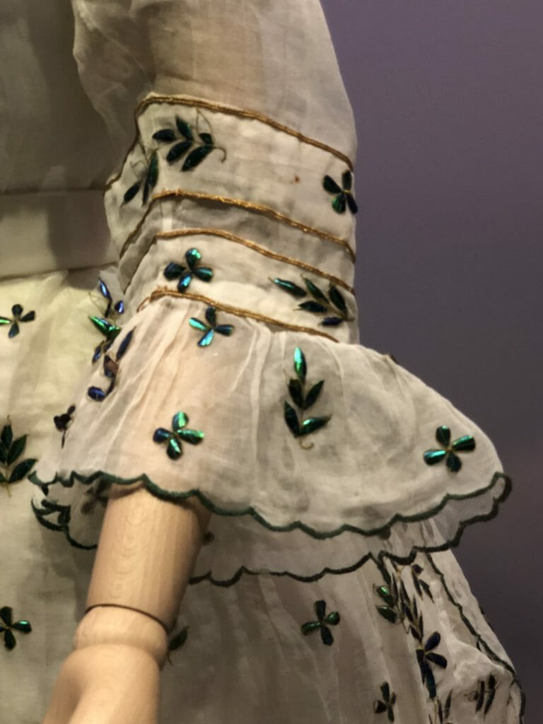 Over 5000 beetle wings and parts of wings were used to decorate this dress from 1868. India imported beetle wing cases and in one instance in 1867 sold 25,000 in one consignment - from Fashioned by Nature at the V&A Museum now