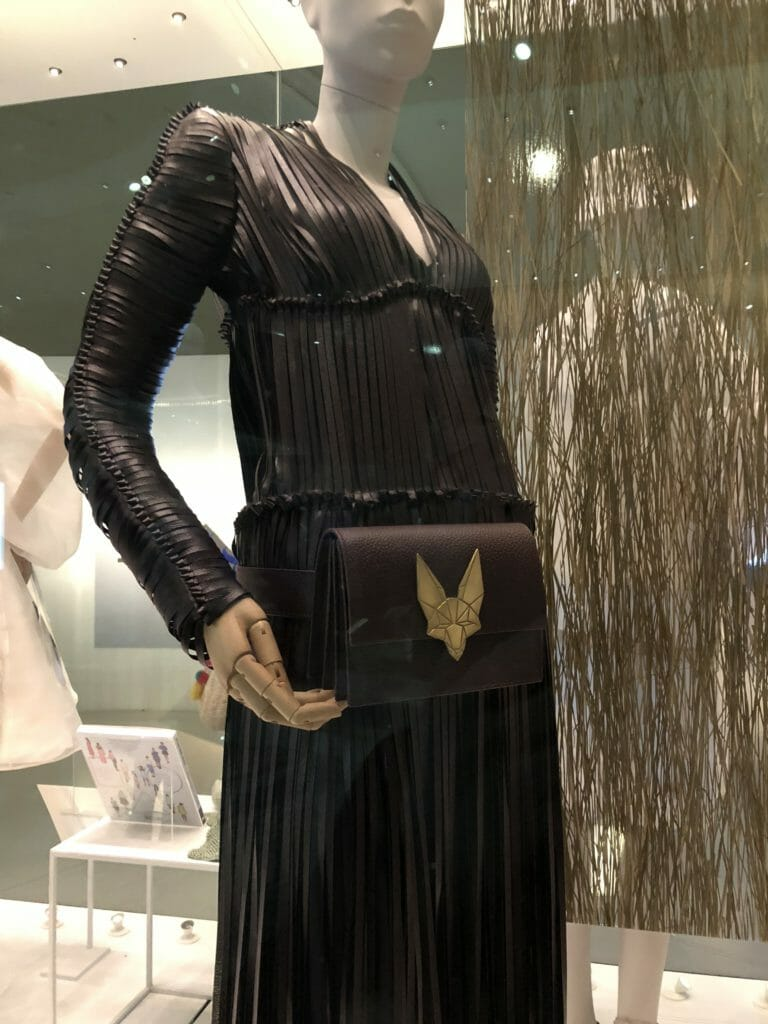 This fringed dress and bag is made from Vegea, an alternative leather made from stalks, seeds and grapes eft over from wine production which was launched as a fashion collection in October 2017 designed by Tiziano Guardini