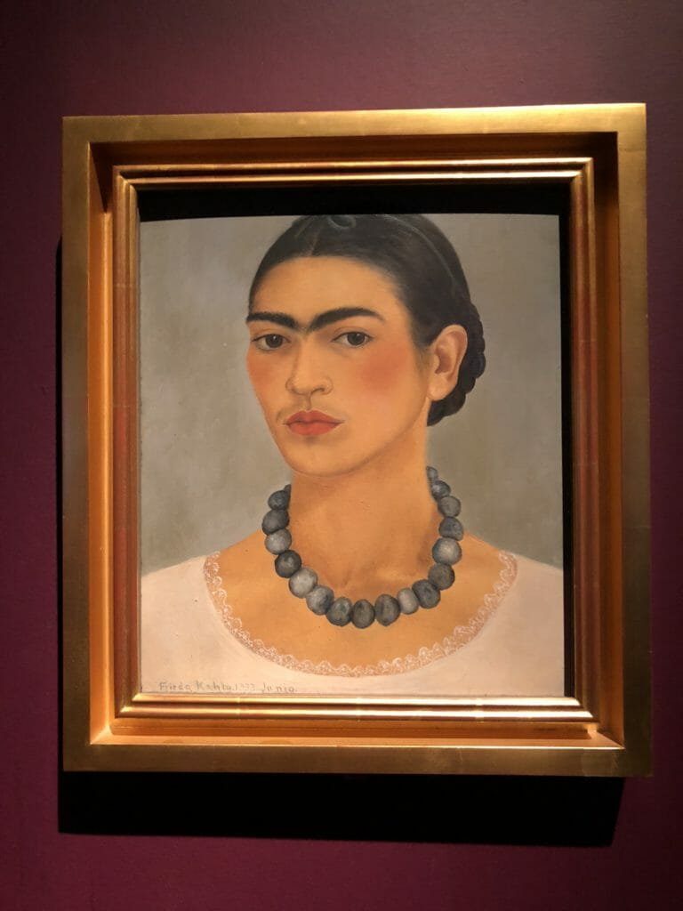 Self portrait iconic of Frida Kahlo from 1933 when she and Diego riviera were living in the US shows her unconventional appearance for the time.