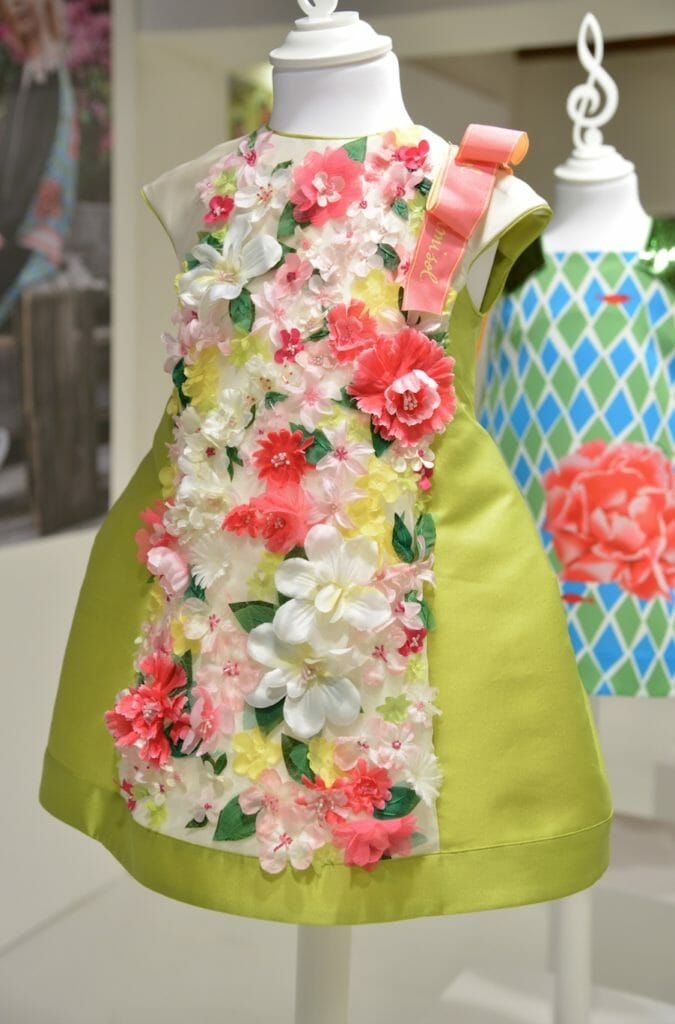 MiMiSol produced a beautiful movie with her own little cinema on her stand this season showcasing her intricate floral decorated girlswear for Pitti Bimbo 87