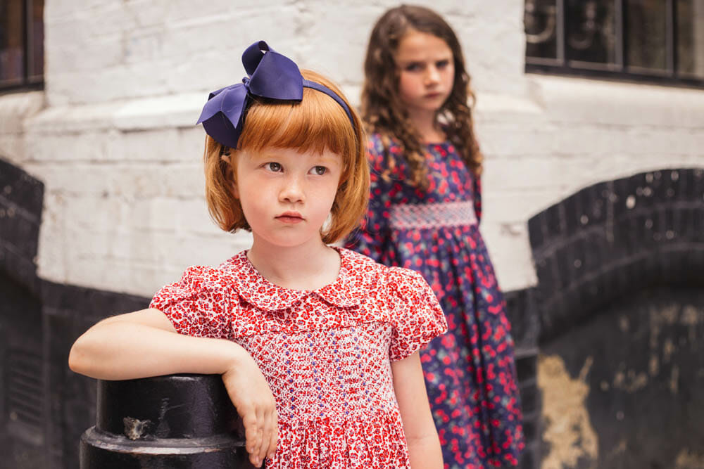The classic Question Everything style has a smocked bodice and a Peter Pan collar