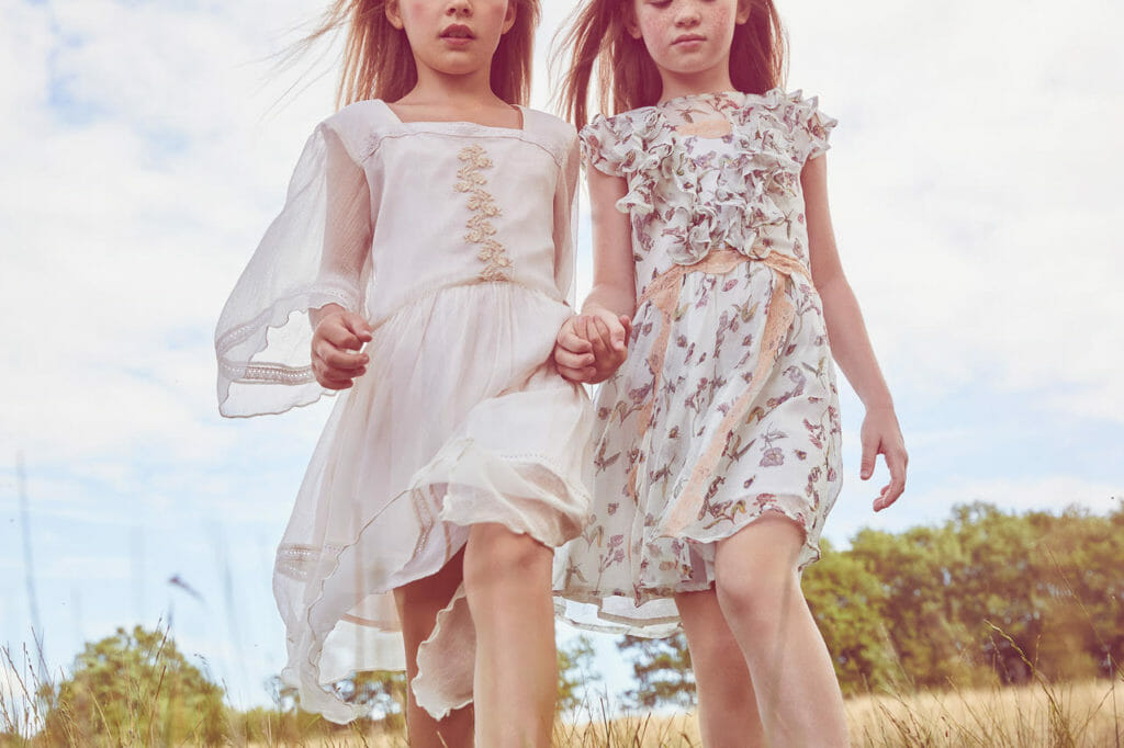 Soft chiffon layers and delicate lace trims are a signature of Their Nibs girlswear