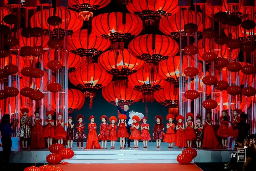 20 models in red at Shanghai fashion week for kids fashion from Italy