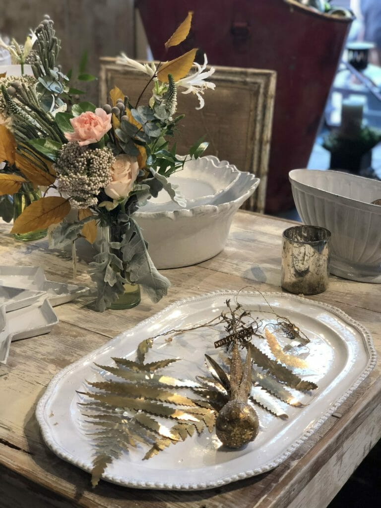 Simple Indian inspired metalwork and chic little bouquets at Petersham Nurseries in the Covent Garden store