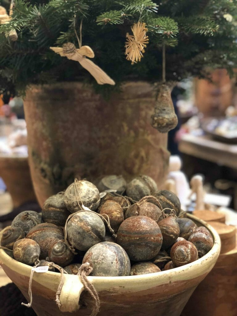 Natural rust effect baubles at Petersham Nurseries in Covent Garden