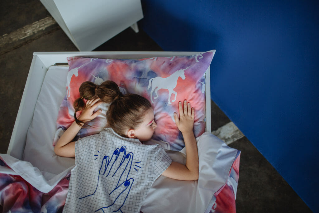 Milk & Biscuits shirt for winter 2018 and unicorn dream bedding, a stylised kids shoot from Dasha Pears
