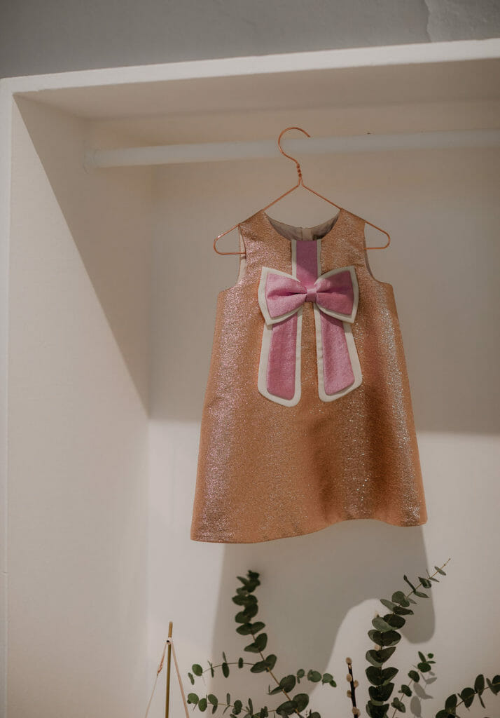 Sweet sequin bow party dress by British label Hucklebones at Pitti Bimbo 88, photo Abi Campbell