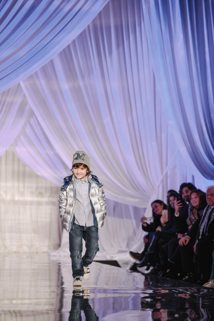Popular for boyswear at Pitti Bimbo 88 was the silver metallic bomber jacket here by Hitch Hiker
