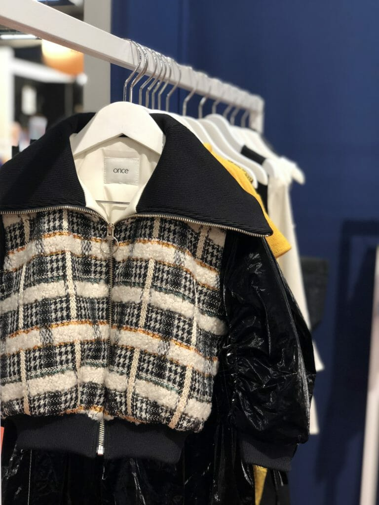 Textured tweed mixed with a newly developed shiny lightweight black fabric at Once for FW19 kids fashion