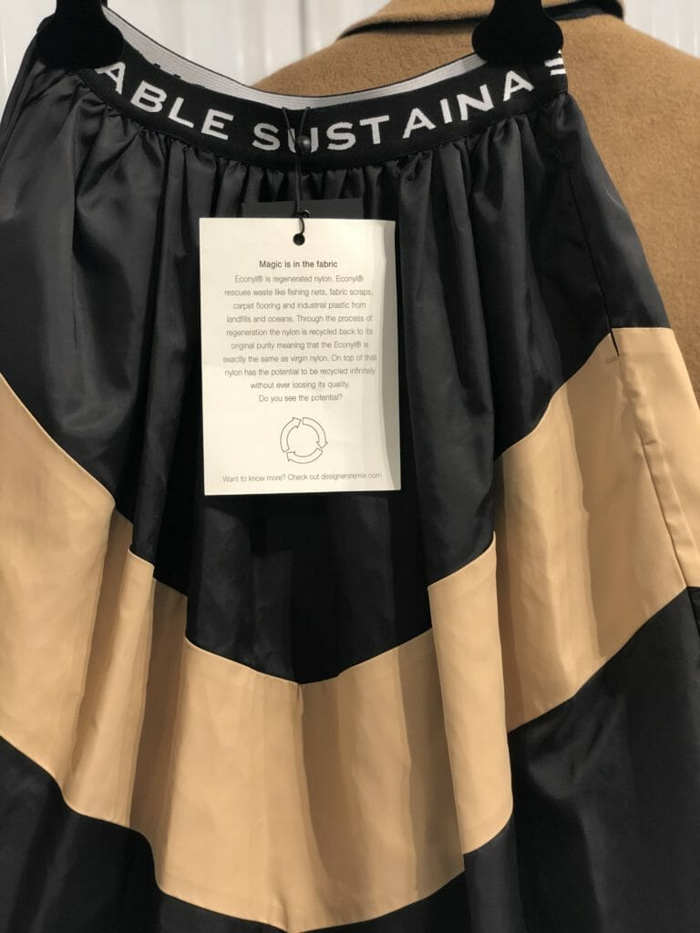 Sustainability and kids fashion with a logo waistband and regenerated nylon skirt at Little Remix for FW19 kidswear at CIFF Youth
