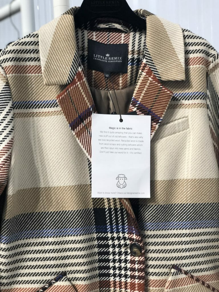 Cool plaid coat by Little Remix which will be renamed Remix Girls for FW19 and a label detailing its recycled wool origins