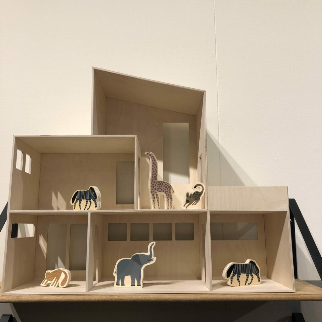 Dolls house by Ferm Living with cut out wooden animals from an early years play set