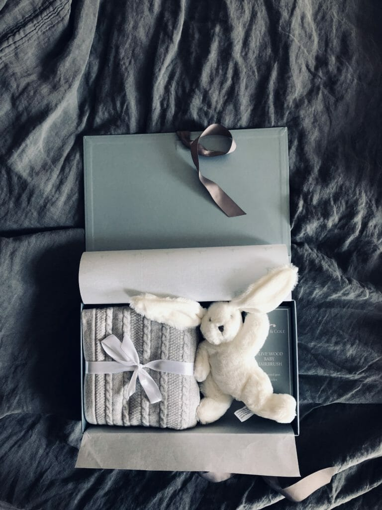 Boxes are neatly packed with options to include soft toys and classic wooden hairbrushes