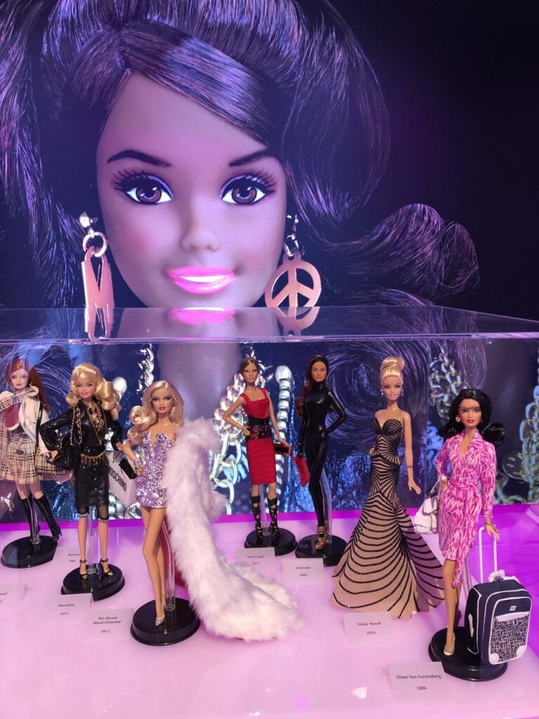 Barbie 60th anniversary display showing designer collaborations of the 2000's at Pitti Bimbo 88