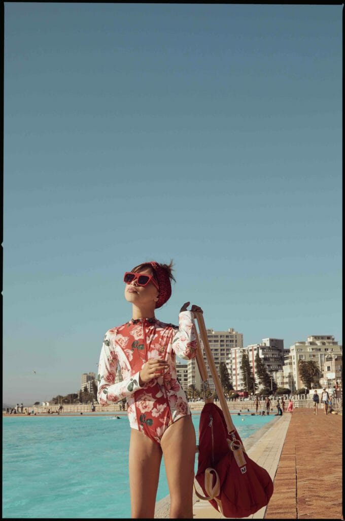Scuba style swimwear by submarine Swim, bag by Molo, sunglasses throughout by Stella McCartney at Childrensalon