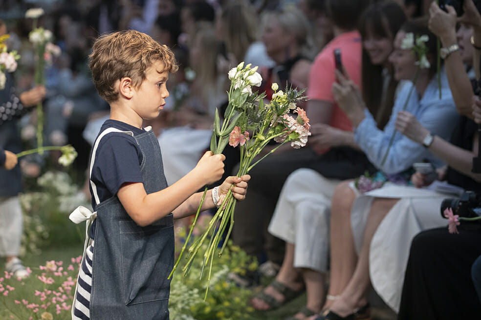 For the catwalk show's finale, apron wrapped mini models handed the audience floral bouquets to take home at Il Gufo Pitti Bimbo 89