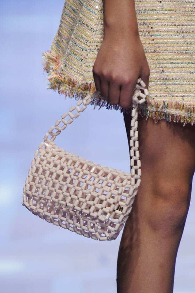 Fringe detail with cool Instagram style open bead bag by Amaya for SS20