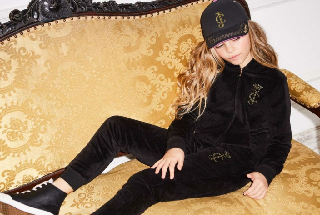 Sports style trends also see the return of the classic velour Juicy Couture track suit in a luxe black version