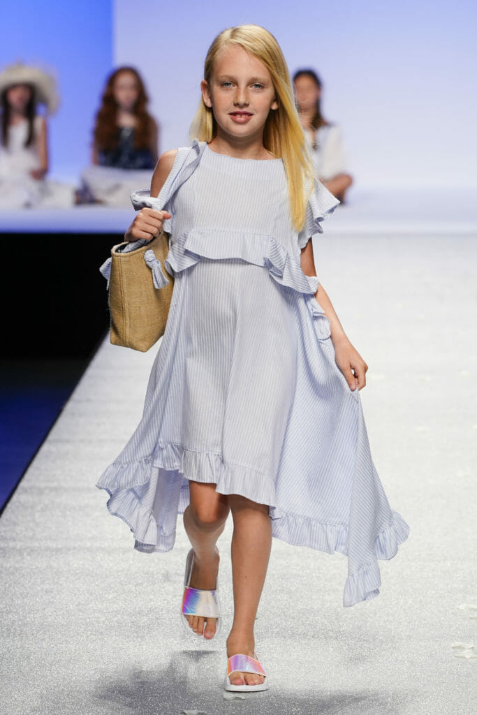 The dip back hem has been a popular trend at the Pitti Bimbo shows for SS20