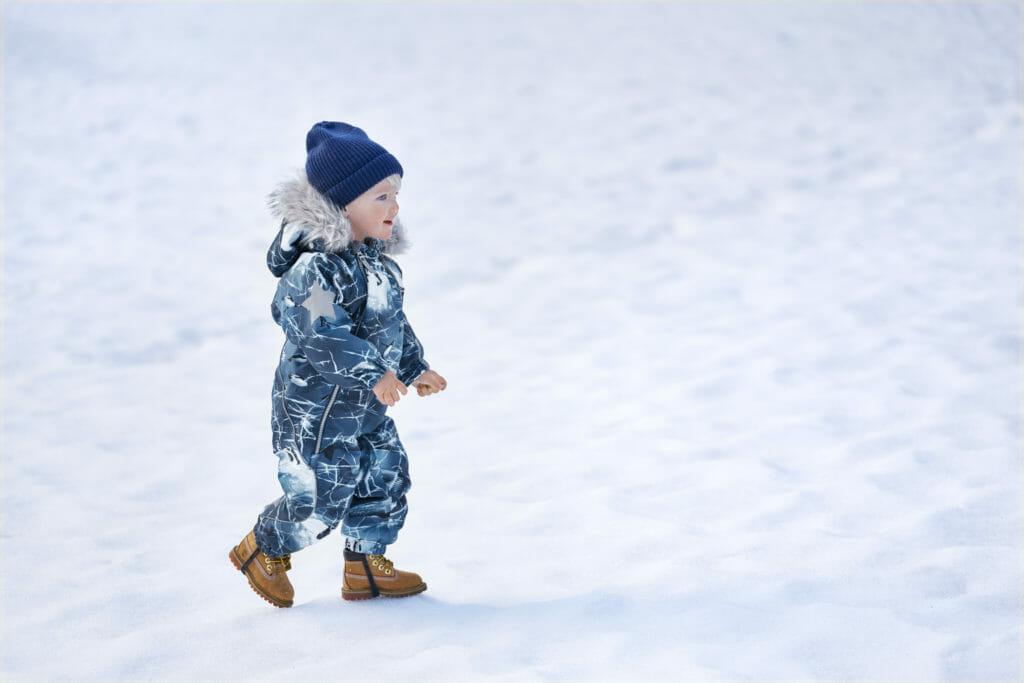 Cute boys breaking ice print snowsuit at Molo for winter 2019 kids skiwear