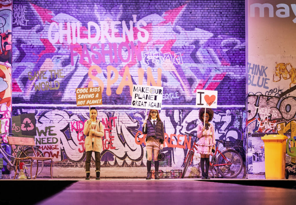 Protest banners at the Childrens fashion from Spain show for Mayoral FW2020