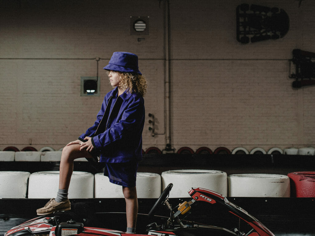 Tonal boys fashion at Boysmans with a deep purple jacket and hat set