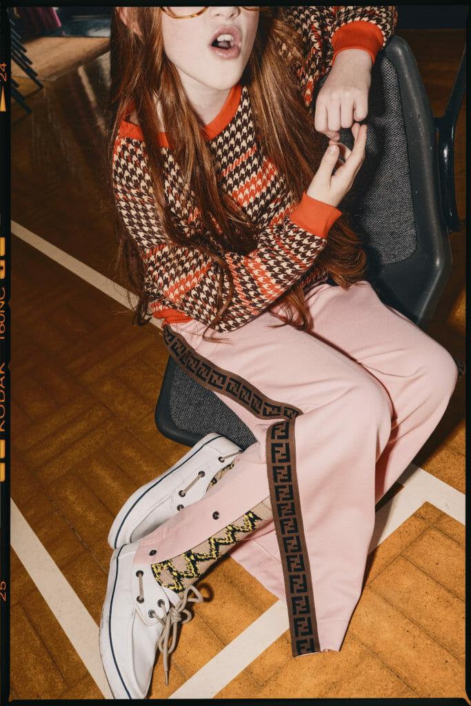 Sweater Mini Rodini, track pants Fendi in this cool kids spring editorial