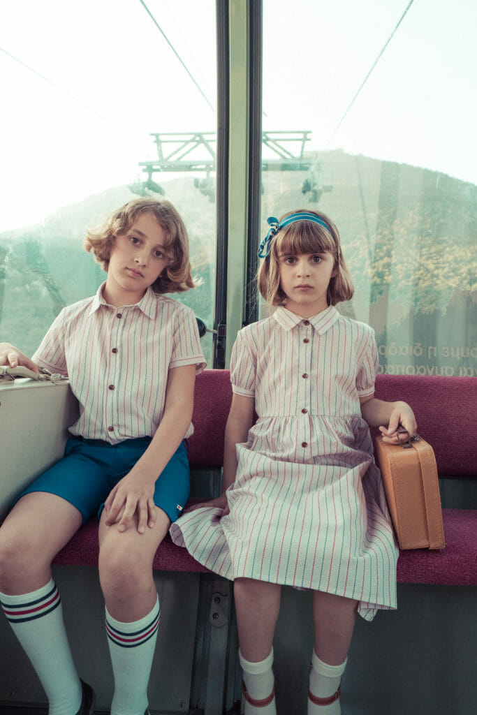 Tres chic Poupée on a summer holiday for SS21 kids fashion